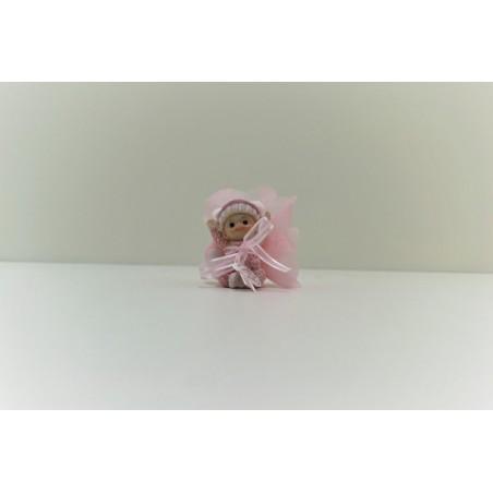 Bébé rose avec pompon